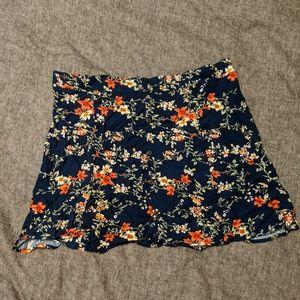 NWOT floral mini skirt w/faux button details